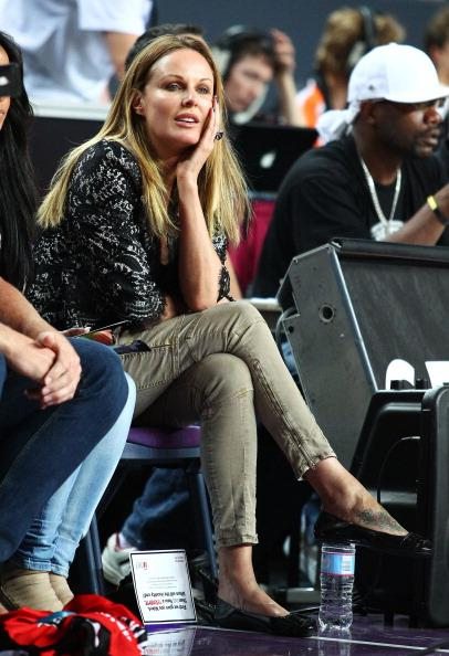 SYDNEY, AUSTRALIA:  TV personality Charlotte Dawson watches the game during the round 12 NBL match between the Sydney Kings and the Perth Wildcats at Sydney Entertainment Centre on December 29, 2010 in Sydney, Australia.