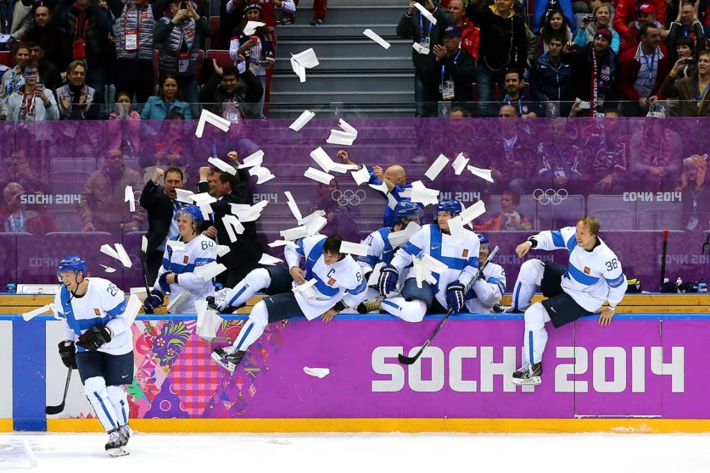 Towels go flying as the Finland bench pour onto the ice to celebrate their 5-0 rout of the USA in the men's ice hockey bronze medal game.