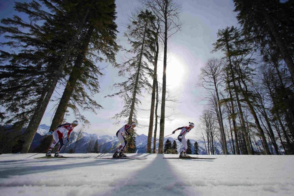 Norway's Marit Bjoergen, Kristin Stoermer Steira and Therese Johaug (left to right) lead during the women's cross-country 30 km mass start free event.