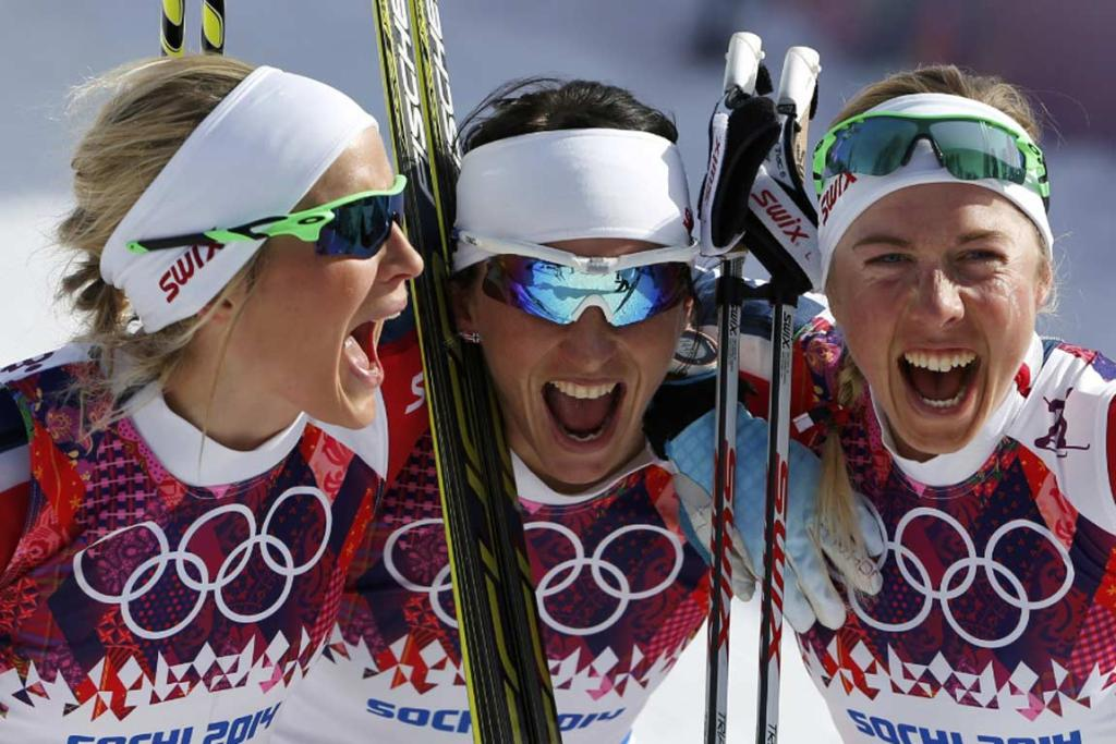 Norway's Therese Johaug, Marit Bjoergen and Kristin Stoermer Steira (left to right) celebrate after winning the women's cross-country 30 km mass start free event.