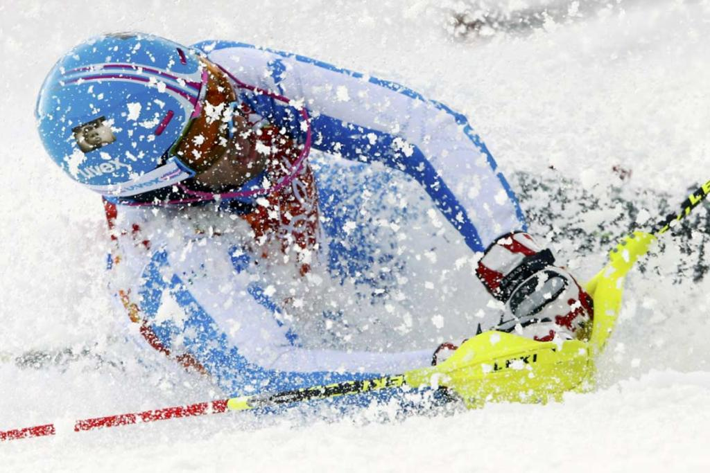 Italy's Patrick Thaler gets a face full of snow after crashing out of the men's slalom.