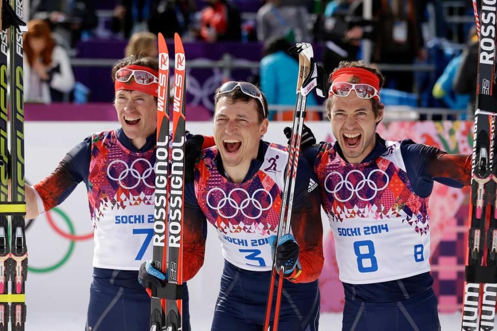 Silver medalist Maxim Vylegzhanin, gold medalist Alexander Legkov and bronze medalist Ilia Chernousov after the host nation swept the podium in the men's 50km mass start cross-country race.