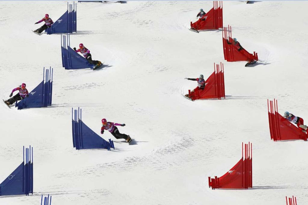 Japan's Tomoka Takeuchi (left) and Switzerland's Julie Zogg compete during the women's parallel slalom snowboarding competition, in this multiple exposure image.