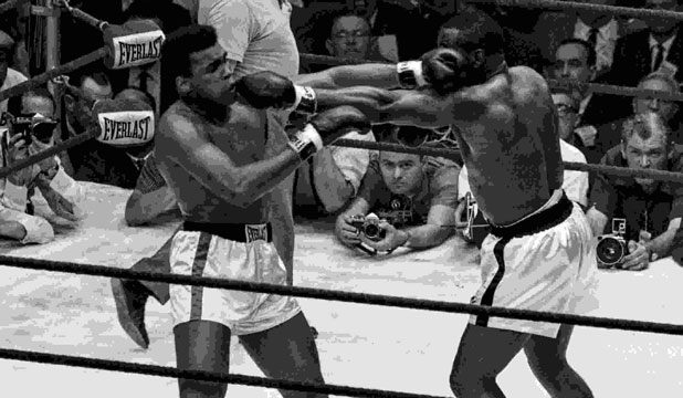 Cassius Clay (left) and Sonny Liston face off in their world heavyweight fight in Miami Beach, Florida on February 25, 1964.
