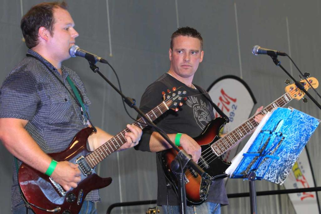 Steven Russell and Brad Smart entertain as the band Hit Men at the Southern Wild Food Festival.