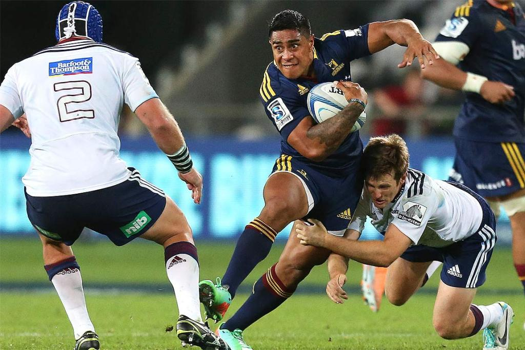 Malakai Fekitoa looks to evade the Blues' tacklers.