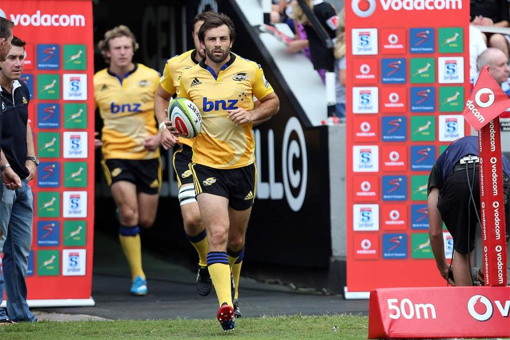 Conrad Smith leads out the Hurricanes for their opening Super Rugby game against the Sharks in Durban.