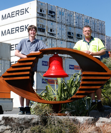 WINNING SMILE: Nayland College student Connagh Boeyen and Port Nelson workshop supervisor Craig Terris with the sculpture in the port's Memorial Garden.
