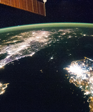EYE OPENING: A crew member on the International Space Station took this night image of the Korean Peninsula. At the top  is China, at the bottom is South Korea and in the darkness is the North.