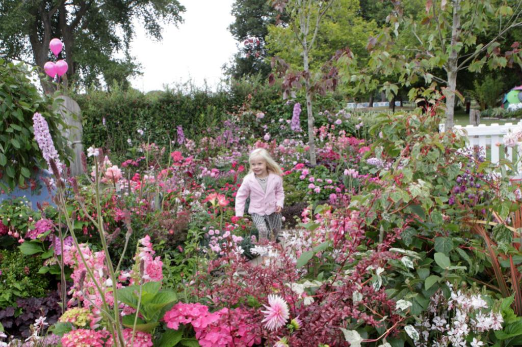 Ellerslie International Flower Show media day, for Gardening page. Passion. Three year old Isla Hastie explores Sally Browns pink garden called -Pas