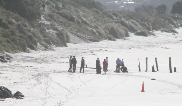 Dunedin police on St Clair beach, where the body of an elderly woman was discovered this morning.