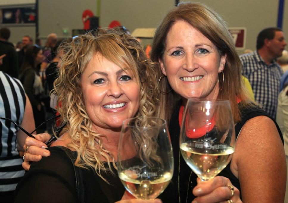 Megan Currie and Leanda Davis enjoy a tipple at the Southern Wild Food Festival.