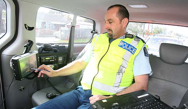 SIMPLE SETUP: Brendon Muir at the controls of Automatic Number Plate Recognition van which alerts police when a car they want to check drives by.