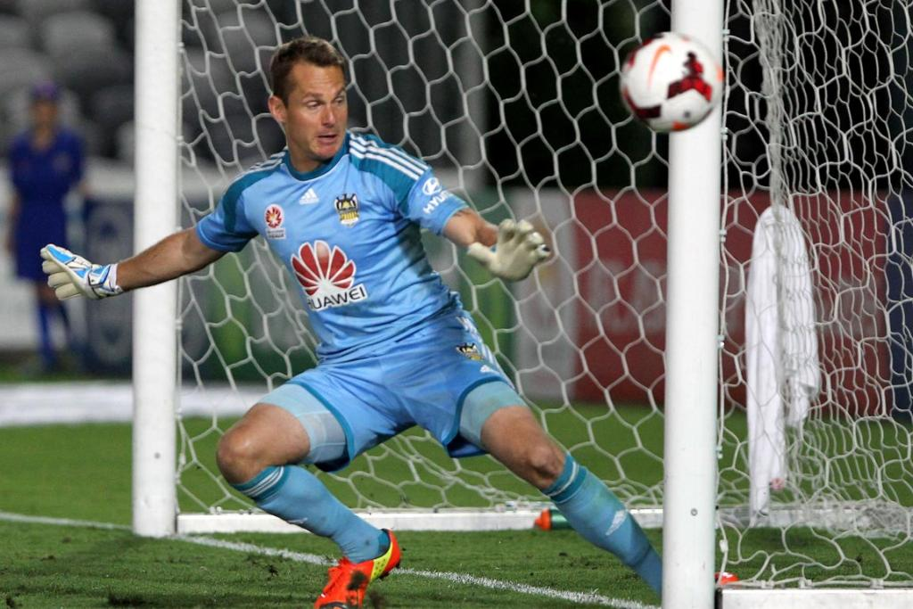 Phoenix keeper Glen Moss makes a save off the line against Central Coast.