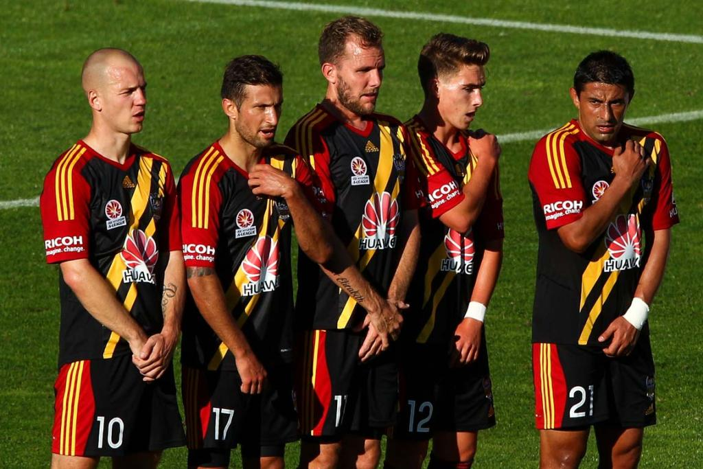 The Wellington Phoenix wall protects themselves before a free-kick.
