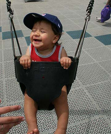 HAPPY DAYS: Iziyah loved the swings before he was diagnosed with an immune disorder.