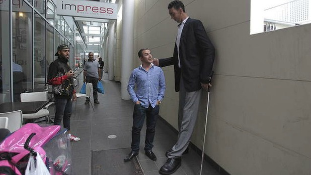 TALL STORY: Sultan Kosen, the world's tallest man, meets Mikail Alkin, who is 169cm, in Auburn on Friday.