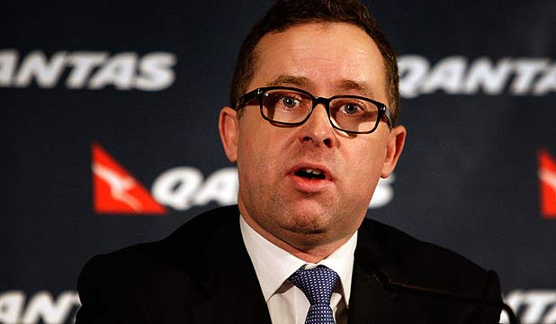 BAD NEWS: Chief Executive Alan Joyce announces the Qantas half year results during a press conference earlier this week.