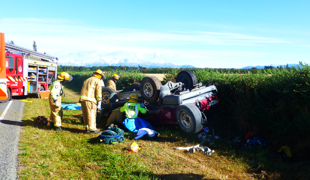 ROLLED: A woman was trapped after her 4WD rolled into a ditch.