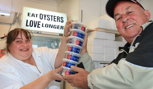 STOCKING UP: Former Southlander Wray Horton who now lives in Brisbane, is  served by Barnes Oysters shop manager Dania Todd.