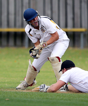 HAPPY IN HIS WORK: New Plymouth Boys' High School wicketkeeper Matthew Boswell shows his delight as he runs out New Plymouth Old Boys batsman Brad Fale during their Taranaki premier grade cricket match at the school grounds on Saturday.