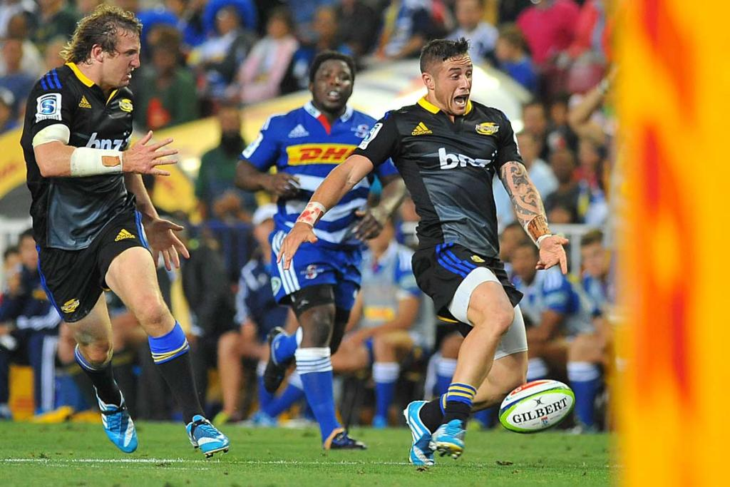 Hurricanes halfback TJ Perenara attempts to toe the ball forward during the second half against the Stormers.