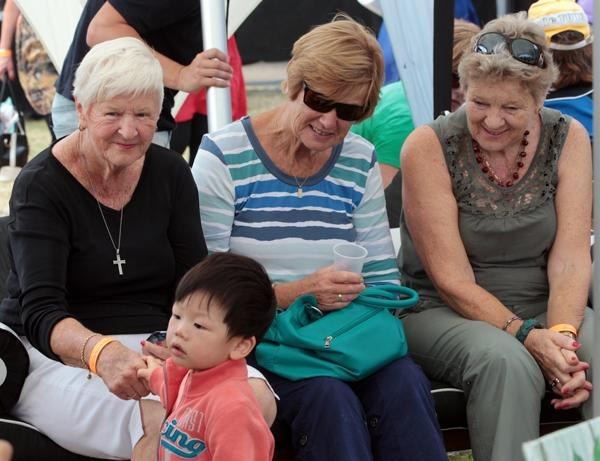 NEW FRIENDS: Sisters Rita Powell, Lesley Welham and Dianne Oldham make friends with 16-month-old Edward Dai of Hamilton.