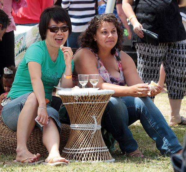 HAPPY VISITORS: Wanda Shen, left, and Monique Virture of Auckland enjoy the food and wine.