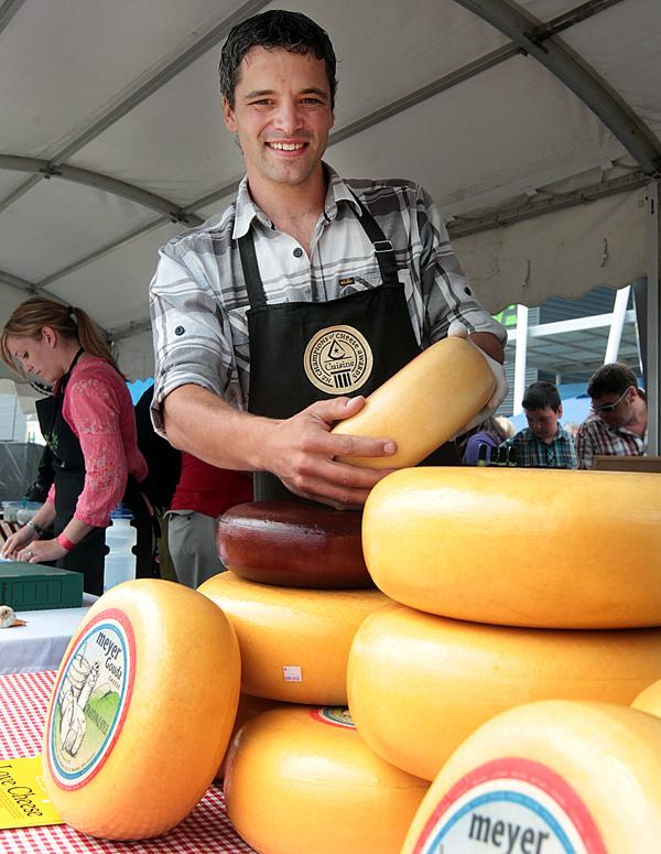 THE BIG CHEESE: Miel Meyer grabs another wheel of his Meyer gouda at the Waikato Food and Wine Festival,  Claudelands.