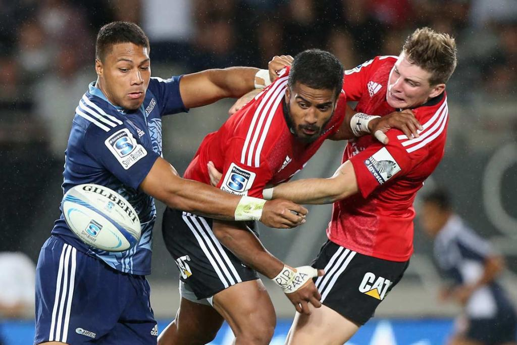 Crusaders Colin Slade (right) and Reynold Lee-Lo fail to secure the ball under pressure from George Moala.