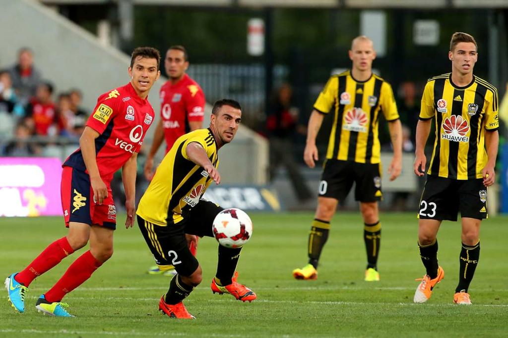 Manny Muscat turns and chases a through-ball by Adelaide.