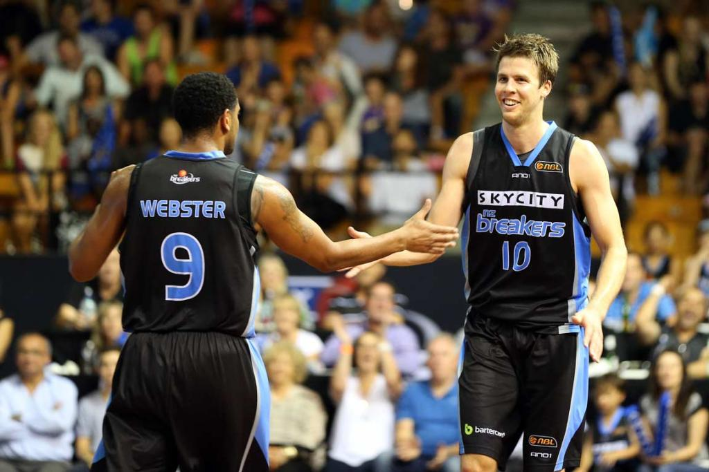 Tom Abercrombie (right) gets some love from team-mate Corey Webster after hitting a three.