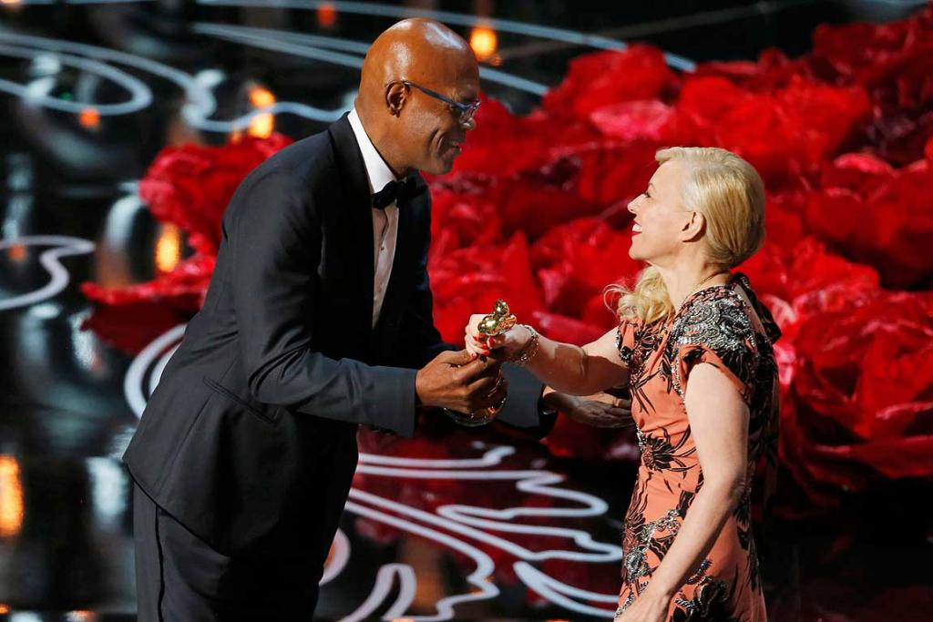 Samuel L. Jackson presents the award for best costume to Catherine Martin for her work in The Great Gatsby at the 86th Academy Awards.