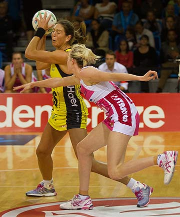 UNDER PRESSURE: Irene van Dyk of the Pulse tries to get a pass away.