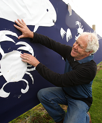 GREAT RESOURCE: South Alive chairman Colin Anderson with the beginnings of the sea banner put up on Elles Rd to commemorate Sea Week.