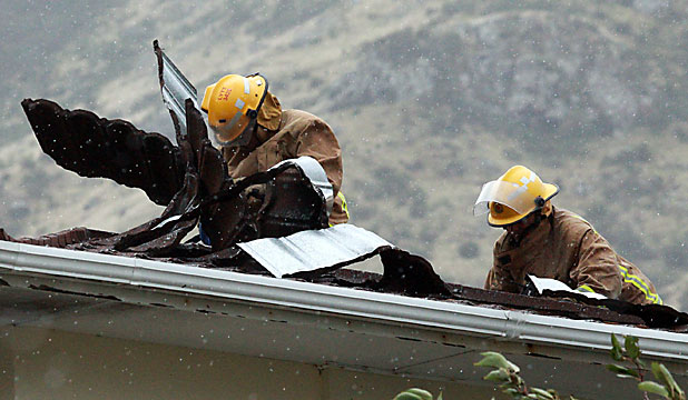 Firefighters repair roof