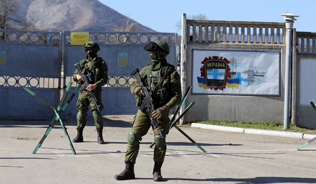 MILITARY ACTION: Russian soldiers stand guard next to a Ukrainian military base in the town of Bakhchisarai in the Crimea.