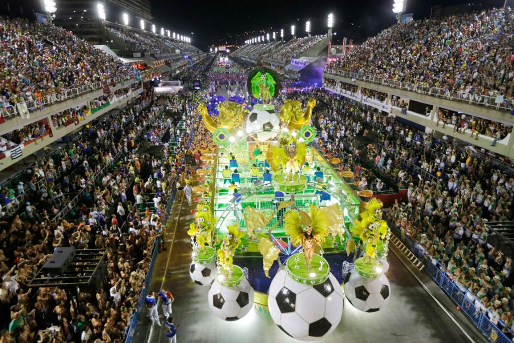CARNIVAL: Revellers from the Uniao da Ilha samba school perform from their football inspired float.