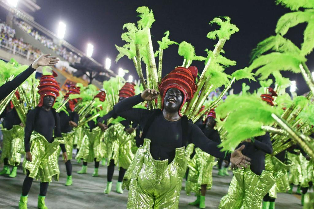 CARNIVAL: Revellers from the Mocidade Independente samba school light up Rio in fluorescent green.