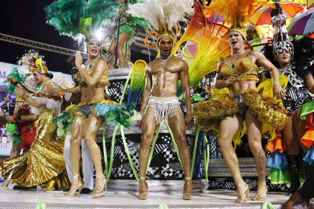 CARNIVAL: Revellers from the Mocidade Independente samba school show there's no gender bias in what you wear.