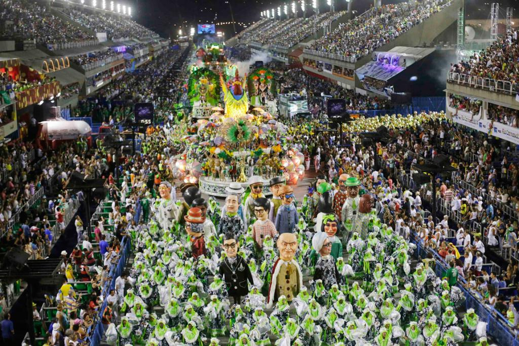 CARNIVAL: Tens of thousands of people cram into grandstands lining the streets of Rio to watch the city's celebration of samba.