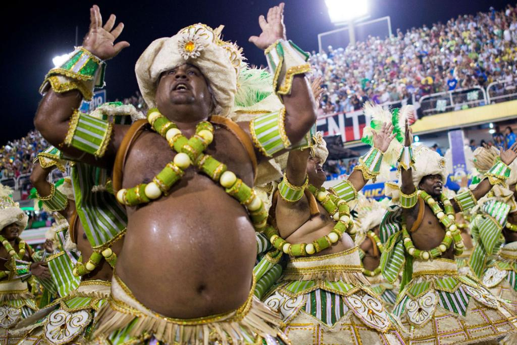 CARNIVAL: Members of Mocidade Samba School embrace the spirit of the party at Carnival Rio.
