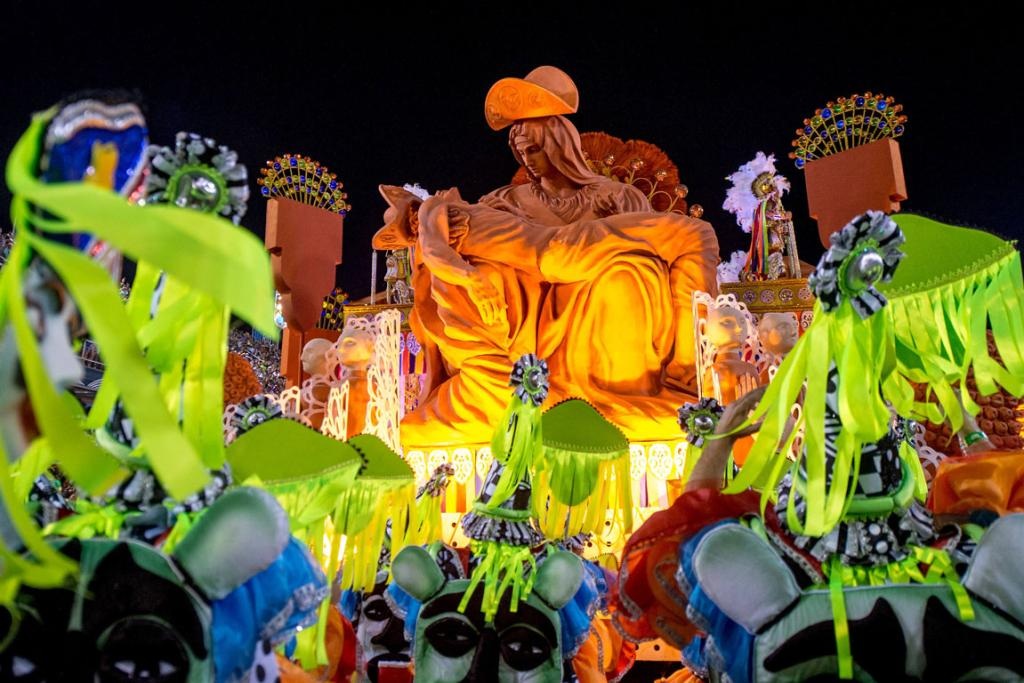 CARNIVAL: A carnival float of Mocidade Samba School depicts a religious scene.