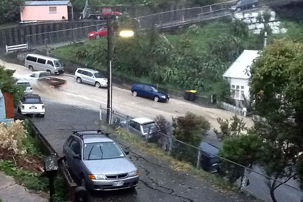 Lyttelton street turns into a river