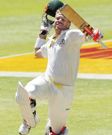 TWO-TON: David Warner celebrates his second century on day four of the series-deciding third test against South Africa at Newlands.