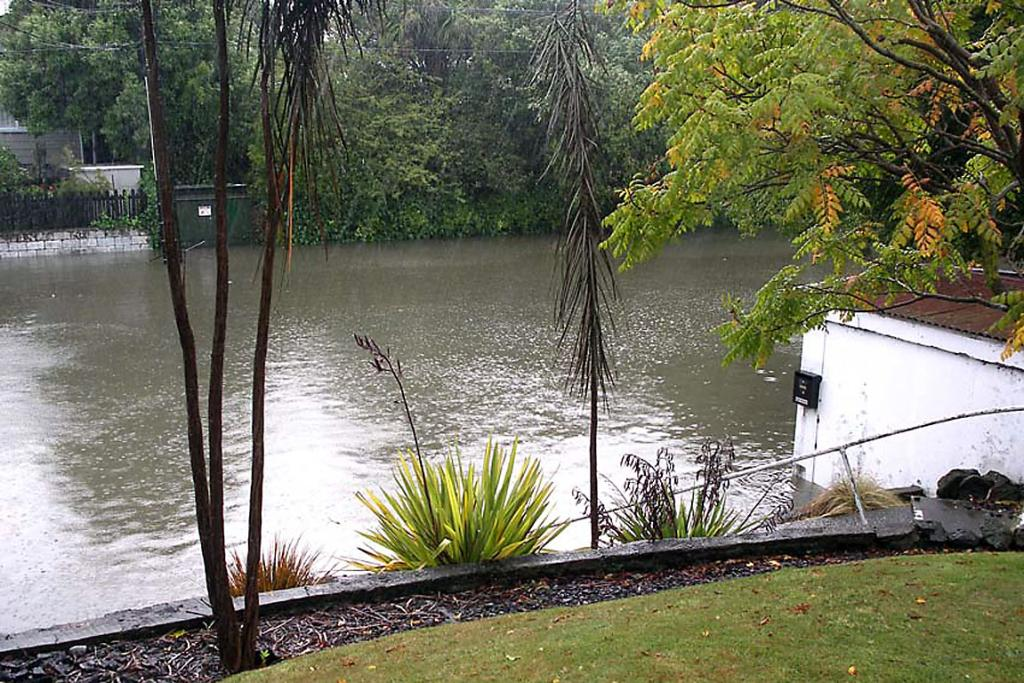 COVERED IN WATER: Mackenzie Ave, Opawa, is turned into an outdoor swimming pool.