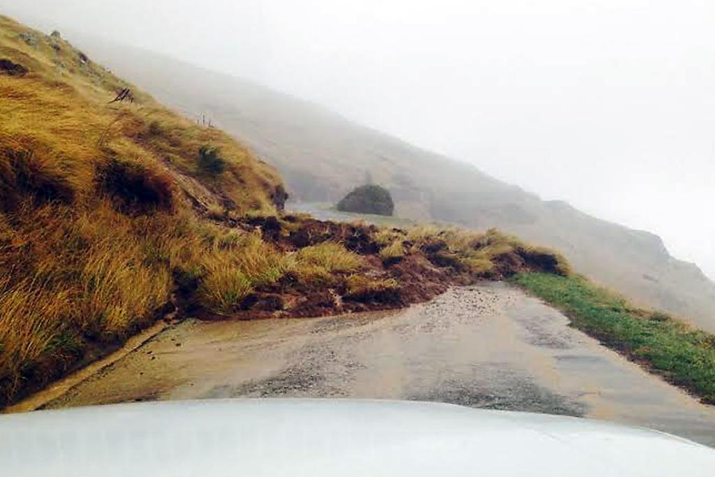 HAZARDOUS DRIVING: Hillside slips along Evans Pass above Sumner.