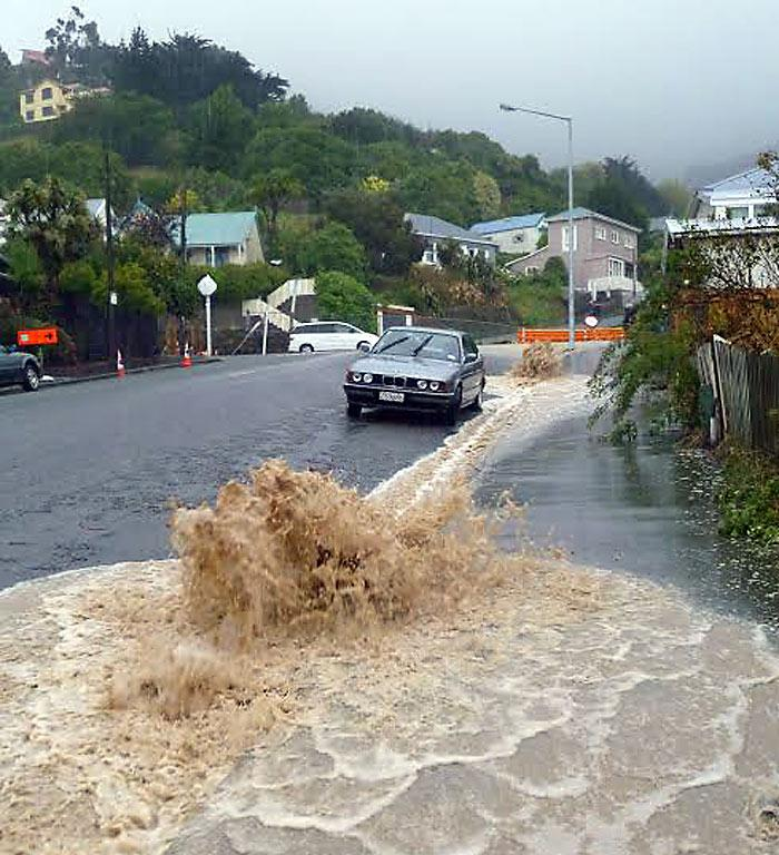 GUSHER: Water pumps out onto Voelas Rd, Lyttelton.