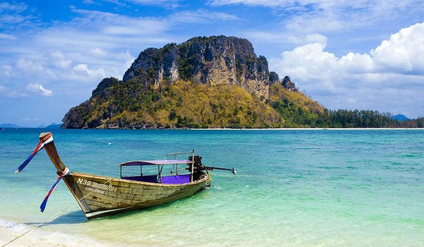 UNSPOILED ISLAND: a Thai longtail boat.