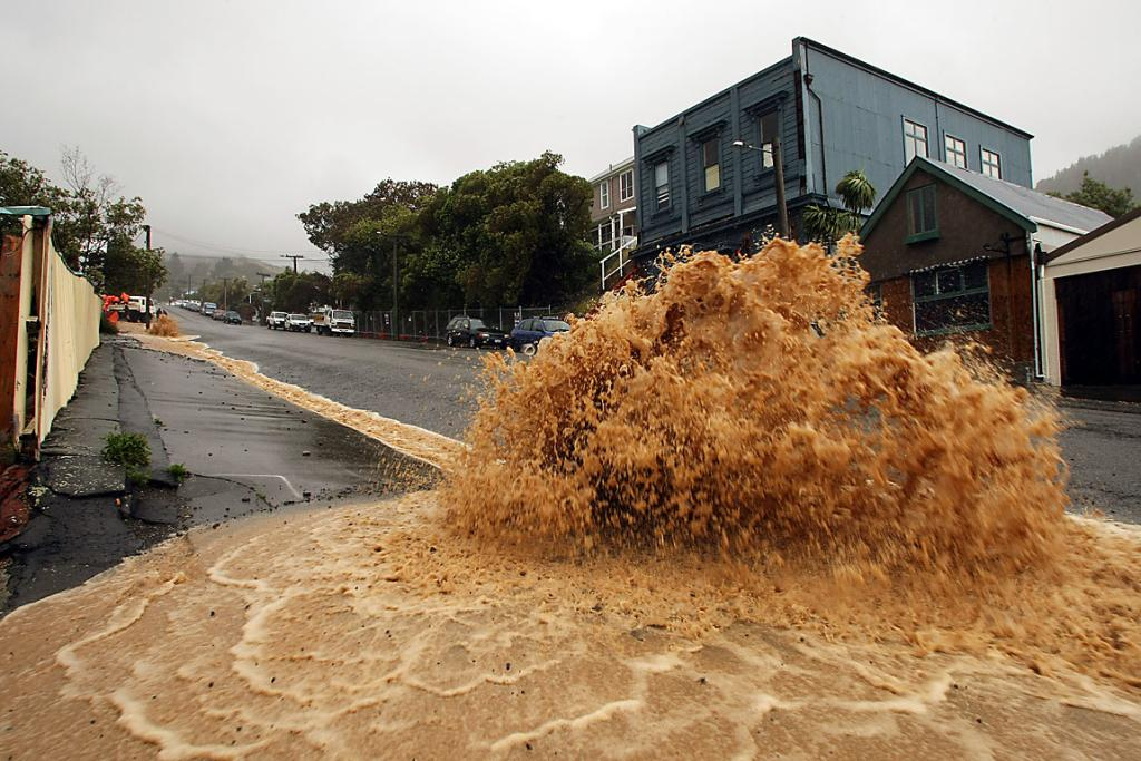 CASCADING: Flooding down Canterbury St in Lyttelton reaches new highs.